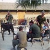 Meskiman picking his teeth, Arbeit back to camera, SSgt Shannon in chair, Mike Brown next to Shannon